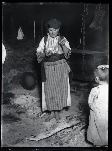 Divination: A woman reading a fortune using amkanje, shelled egg used also for ritual             purposes: , ca. 1932