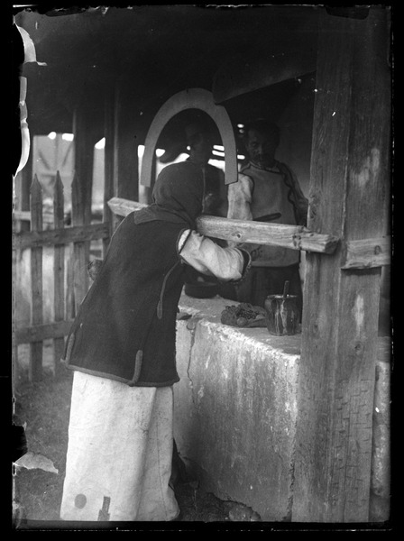 Death: Mother distributing gifts of food for her son, every Friday and Sunday until             half a year after the death. Later too?: , ca. 1932