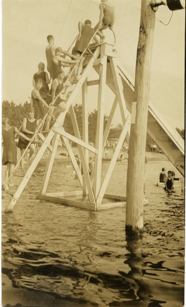 Climbing the water slide, Lake Rohunta, ca. 1925