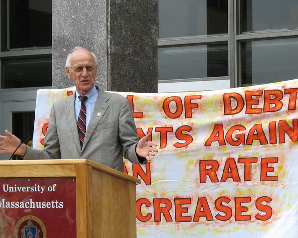 Congressman John W. Olver in front of the UMass Amherst Student Union Building, speaking at             a rally against student loan debt, May 3, 2012