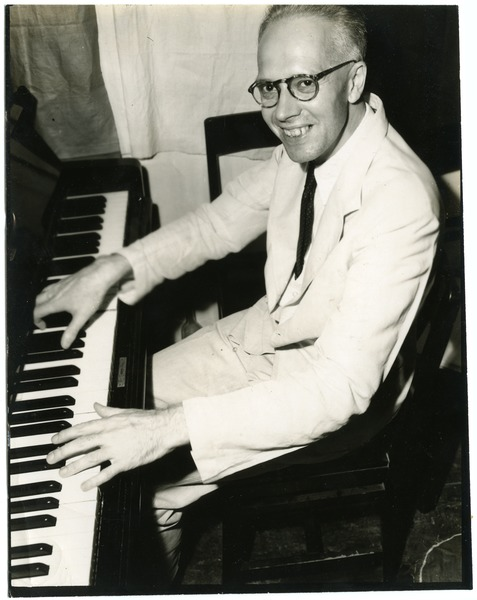 W. L. Holland at the piano, July 3, 1945