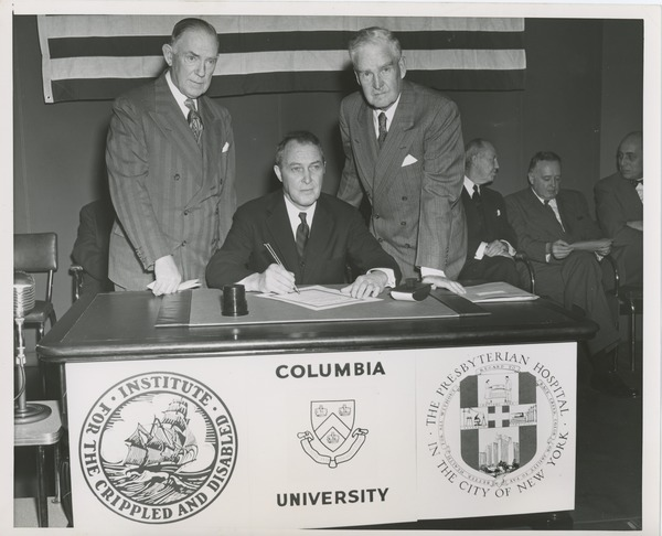 Joseph Campbell, treasurer at Columbia University, signing affiliation agreement, January 31, 1952