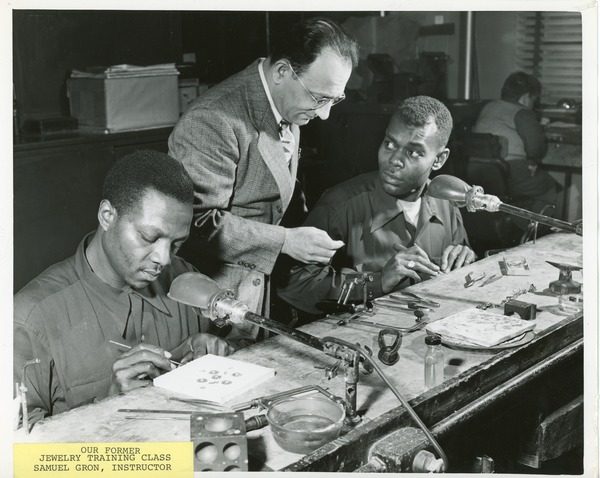 Samuel Gron instructing clients in a jewelry training class, 1965?