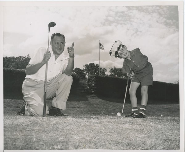 Billy Bruckner and his father posing at a golf course, June 3, 1955