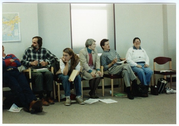 Organic Farmers Associations Council meeting: people seated around the edge of a