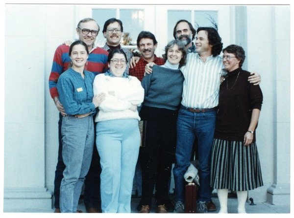 Organic Farmers Associations Council meeting: group posed by a doorway, December 1989