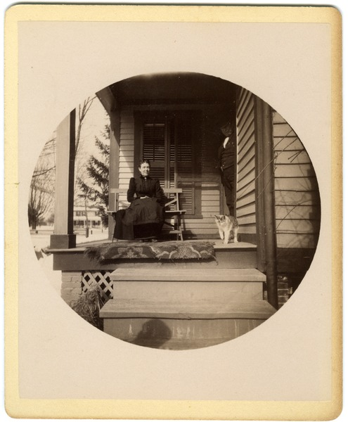 Annie Elizabeth Brown with father Hammond and cat, ca. 1890