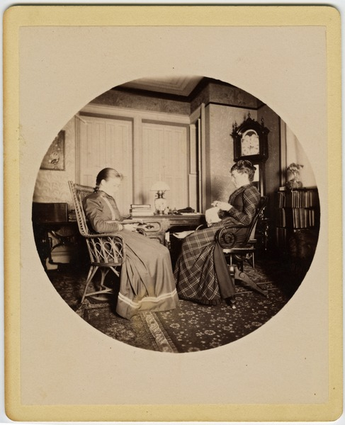 Abby F. Blanchard and Annie Blanchard (l. to r.) seated in the parlor, ca. 1890