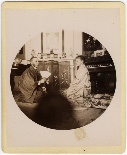 C. P. Blanchard and Abby F. Blanchard seated on the parlor floor, wearing kimonos, ca. 1890