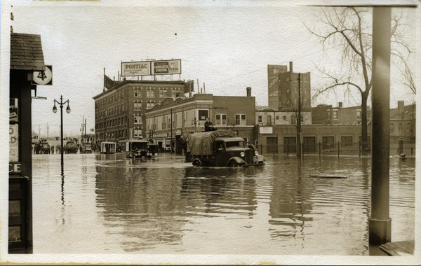 Aftermath of the great Hartford Flood: Relief trucks driving through flood waters, probably State Street: , ca. March 1936