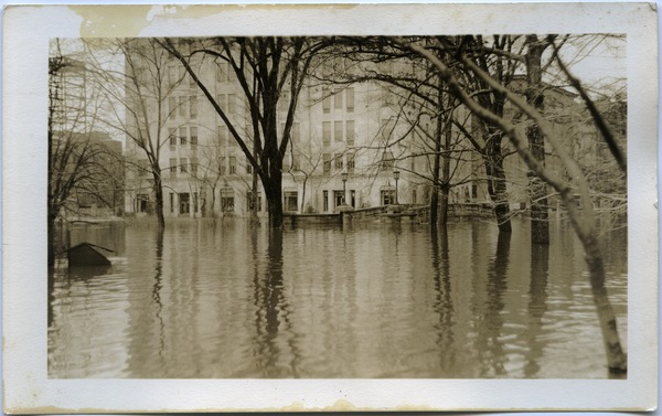 Aftermath of the great Hartford Flood: Flooding at edge of Bushnell Park (corner of Trumbull and Jewell Streets): , ca. March 1936