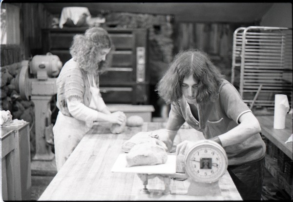 Marleen McCarty and Sammy Wolf, working in commune bakery, ca. November 1, 1972