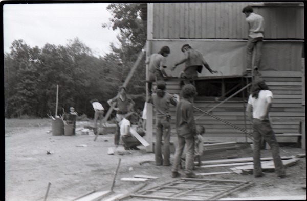 Group putting up clapboards on commune building, ca. November 1, 1972