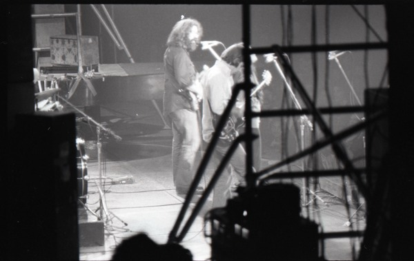 Grateful Dead concert at Springfield Civic Center: shot from behind the stage of         Jerry Garcia (guitar), ca. March 28, 1973