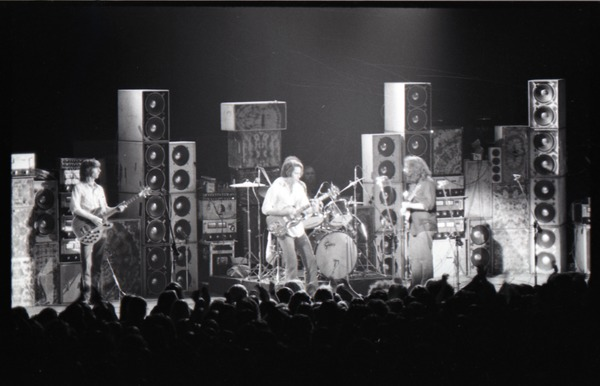 Grateful Dead concert at Springfield Civic Center: band in performance in front             of a wall of speakers, ca. March 28, 1973