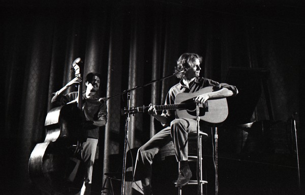 Livingston Taylor in concert: Taylor (acoustic guitar) and Walter Robinson             (acoustic bass), ca. 1973