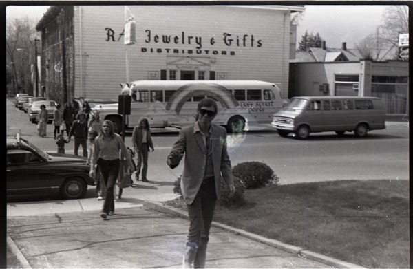 Group of commune members arriving, Free Spirit Press bus parked in background, ca. 1972