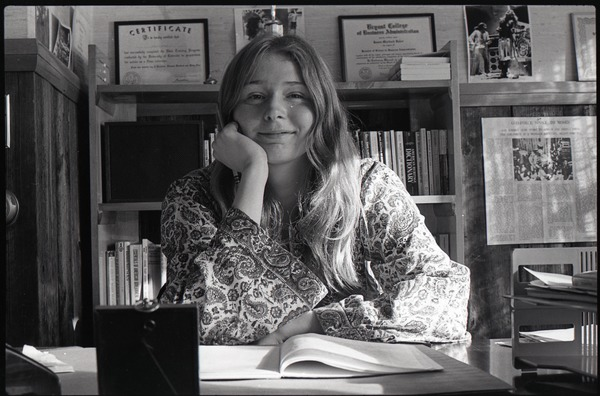 Lynn Smith at desk in Free Spirit Press office, ca. 1973