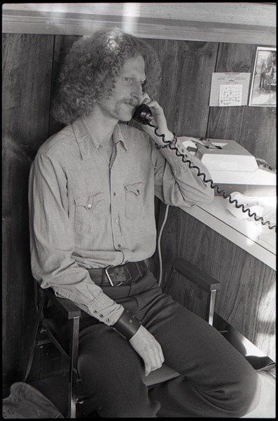 Gordon Adams on the phone in the Free Spirit Press office, ca. 1973