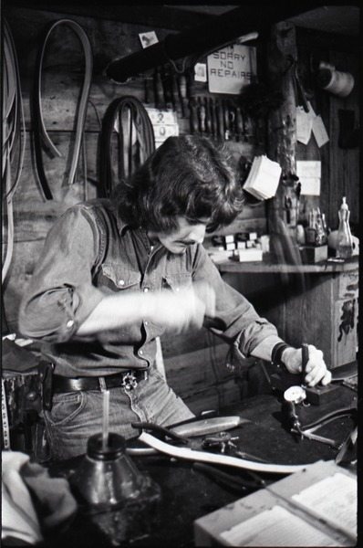 Don Muller working at his bench, the Leather Shed, ca. 1973