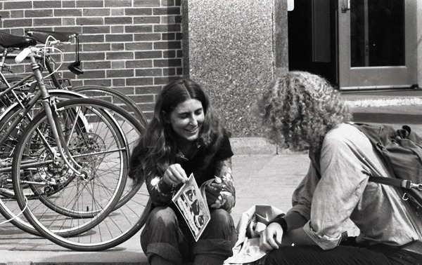 Free Spirit Press crew distributing the magazine to a young woman outside the             UMass Amherst Student Union, ca. November 3, 1972