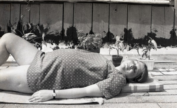 Pregnant woman, basking in the sun, ca. 1973