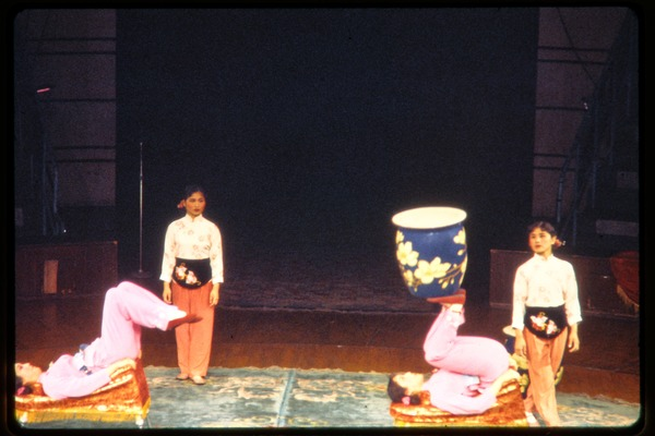 Shanghai acrobats: acrobats juggling a large vase on their feet, June 1978