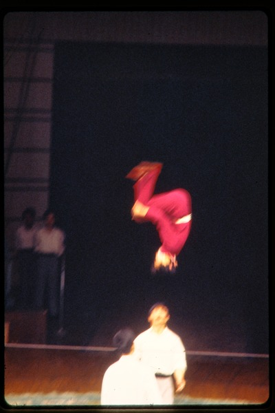 Shanghai acrobats: woman doing a flip on taut line, June 1978