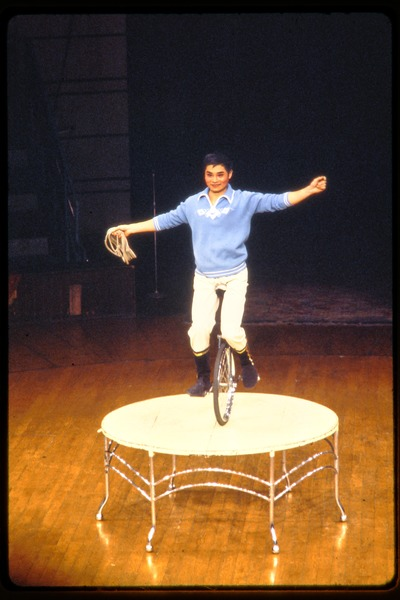 Shanghai acrobats: man on a unicycle balancing on a table, June 1978