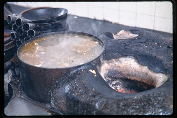 Woks, boiling pot, and stove, June 1978