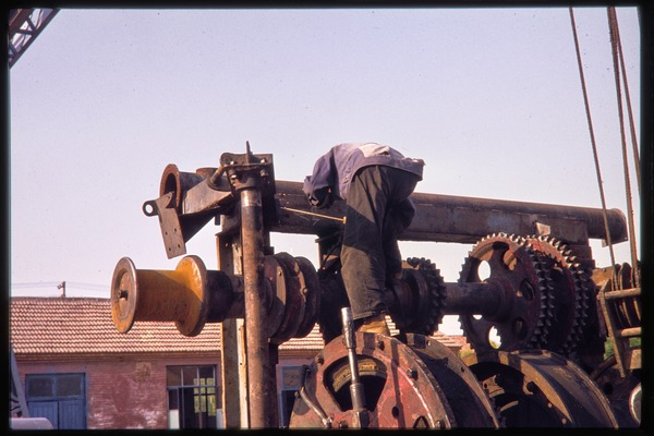 Oil worker and equipment, June 1978