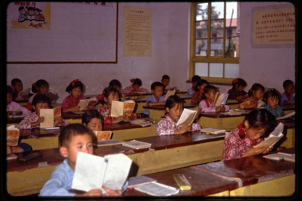 Shijiazhuang Production Brigade: schoolchildren in classroom, reading at their             desks, June 1978