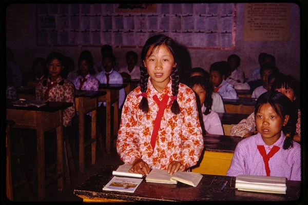 Shijiazhuang Production Brigade: young schoolgirl in classroom, standing and             reading aloud, June 1978