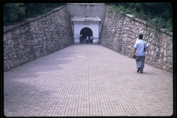 Visit to the Ming Tombs: stone walkway descending into the tombs, June 1978