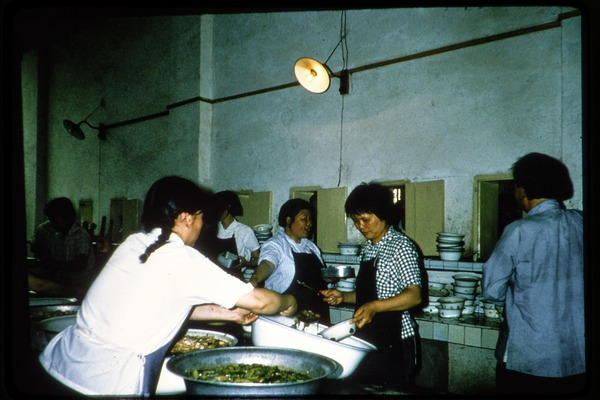 Judy's slides [Judy Weinstein?]: food preparation in a large kitchen, June 1978