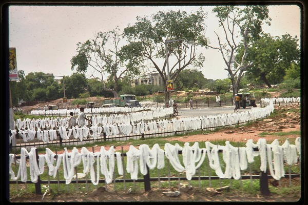 Fencing draped with white cloth, ca. July 1978