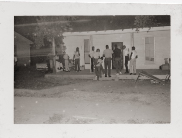 Group gathered at might on the porch of Rust Avenue house rented by the Congress of Federated Organizations (COFO), ca. 1965