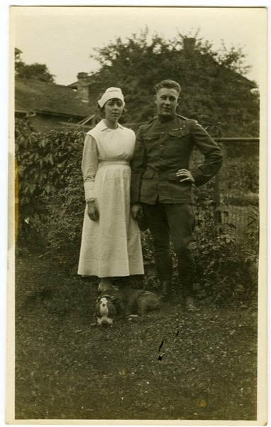 Lawrence D. Yeomans, in uniform, standing with unidentified nurse and bulldog, ca. 1918