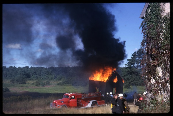 Shanties burning, Duxbury Cranberry Company: Fire engine in front of burning shanty: , 1963