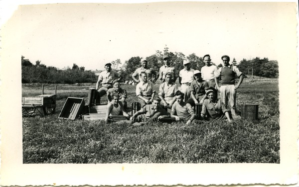 Duxbury Cranberry Company: German prisoners of war from Camp Edwards (Cape Cod)             harvesting cranberries, posed with hand scoops and crates, ca. 1940