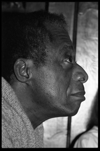 James Baldwin: informal portrait in profile, close-up, at the book party for Robert H. Abel, November 1985