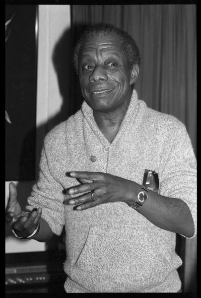 James Baldwin: informal portrait, gesturing, at the book party for Robert H. Abel, November 1985