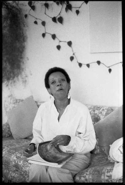 Cuban writer Nancy Morejón, seated on a couch, ca. 1989