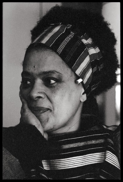 Toni Cade Bambara: portrait with head resting on her hand, ca. 1987