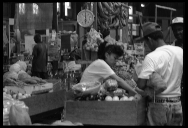 Woman selling produce at a market stall in the old marketplace, Belize City, 1993