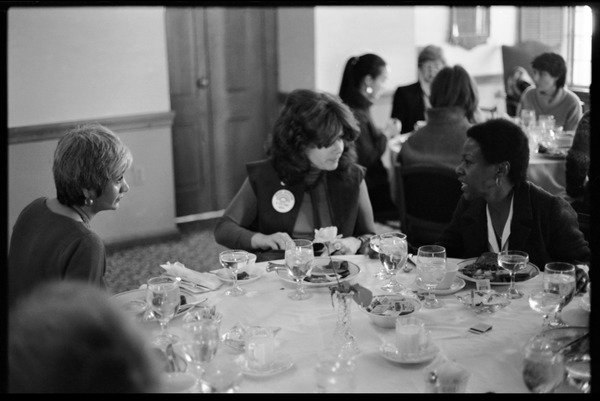 Meline Kasparian, Lisa Bskin, and Esther Terry (l. to r.) seated for lunch at Frances Crowe's party, 1984