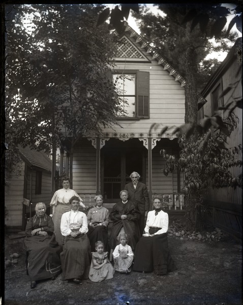 Cottage and residents, Lake Pleasant: Group posed in front of a cottage: , ca. 1900