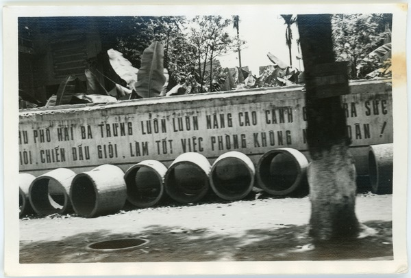 Solo concrete bomb shelters stockpiled in French Quarter street, May 1968