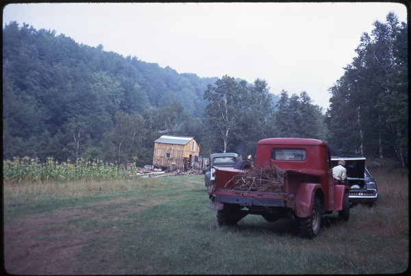 Red pickup truck parked in front of the house, Johnson Pasture Commune, August 1969