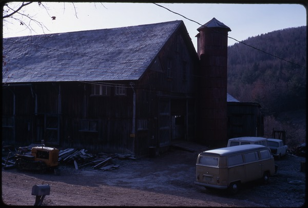 The barn and silo, Montague Farm Commune: Volkswagen microbus and tractor parked in front: , November 1970